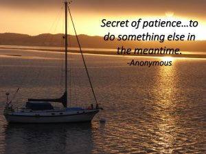 secret of patience message written on a photo of a moored yacht facing the setting sun